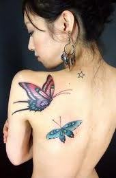 Girl with butterfly tattoo on back shoulder